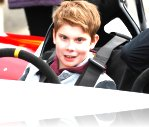 Aaron sits in the Speed Of Sight track car as he prepares to take it for a spin around Three Sisters race track.